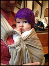baby with CLICK for Babies purple cap